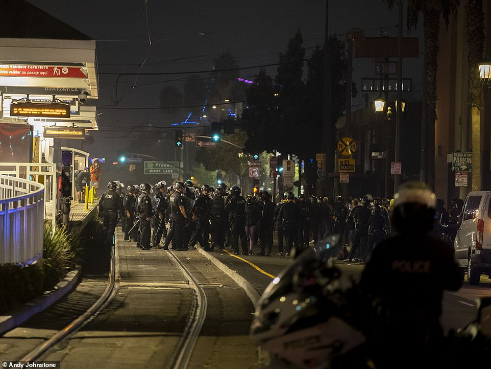 LOS ANGELES: A line of police stand in an intersection near the Staples Center after an unlawful assembly was declared
