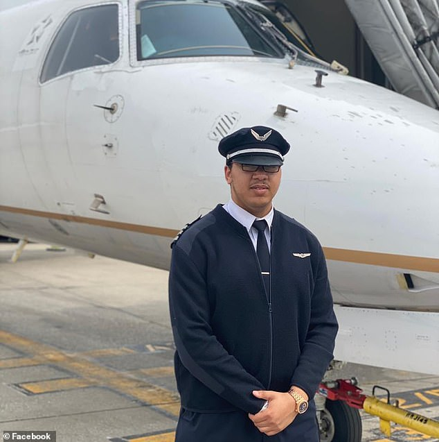 Flying high: Malik Sinegal, 23, from Mississippi, last month became the youngest ever black Boeing 777 pilot in the world