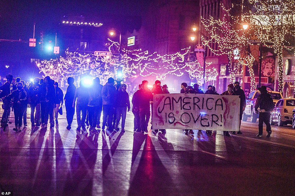 MINNEAPOLIS: Demonstrators wave a banner reading 'America is over' in uptown Minneapolis Tuesday night