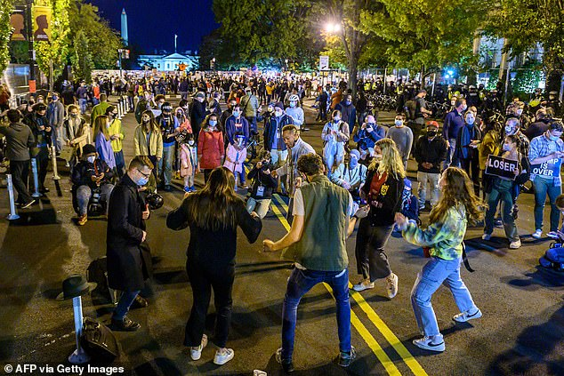 Young activists and Democratic party candidate supporters gather and dance on Black Lives Matter Plaza just outside of the White House