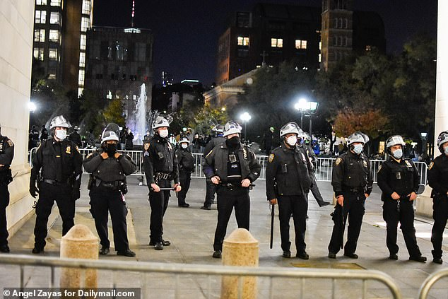 A small group of protesters gathered at Washington Square Park.NYPD fenced in the monument and had officers surrounding the park as they warned protesters not to block traffic and to stay on the sidewalk