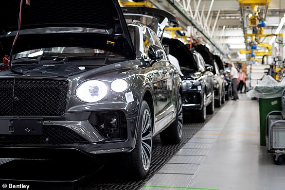 Bentley said the Crewe factory will will be both carbon and plastic neutral by 2030. Pictured, the assembly line full of gas-guzzling Bentayga SUVs