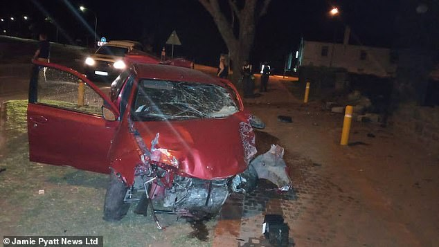 The driver's red car was badly damaged after the crash that saw the car fly over 100 feet in the air