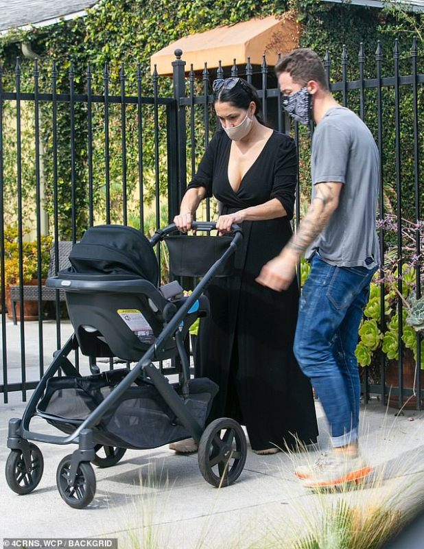 Voting parents: Nikki Bella and fiance Artem Chigwintsev were seen taking the baby's son, Mato, for a walk in their stroller in LA's Studio City neighborhood on Thursday.