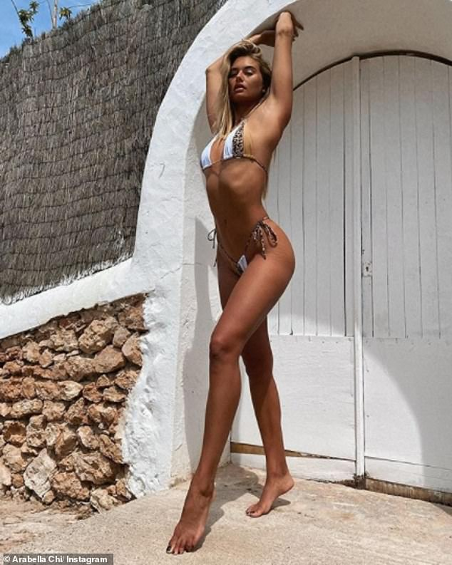 Looking good:Last month, Arabella showed off her bronzed physique during a recent tropical shoot, where she bemoaned Britain's freezing autumn temperatures