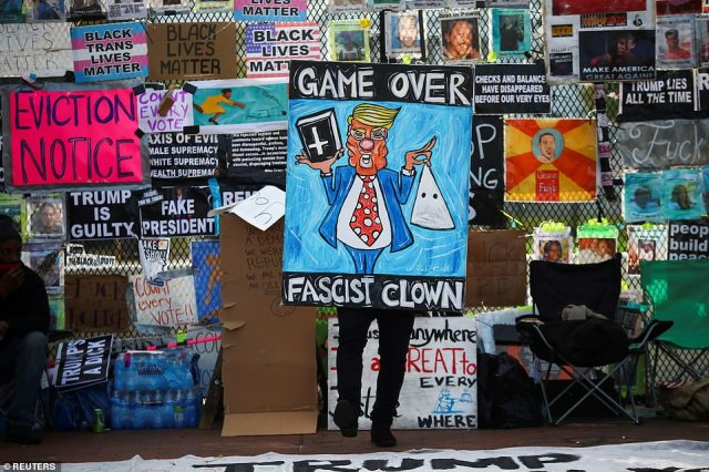 Protesters descended on the White House on Friday with signs calling Trump a 'fascist clown'