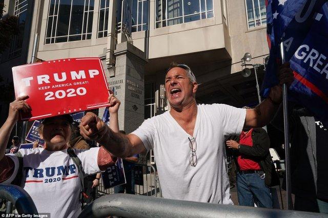 Trump supporter Michael Breitenbach screams outside the Pennsylvania Convention Center as ballot counting inside for the presidential election, on November 6, 2020 in Philadelphia
