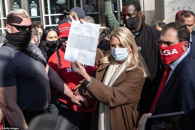 Former Florida Attorney General Pam Bondi speaks to the media about a court order giving Trump's campaign access to observe vote counting operations on Thursday in Philadelphia, Pennsylvania