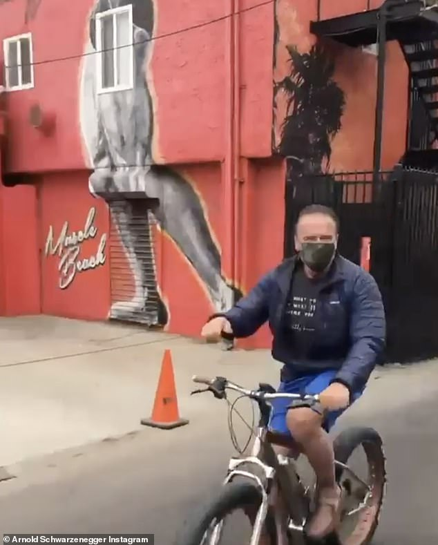 A jollier mood:Schwarzenegger also took to social media to share images of himself in front of a Muscle Beach painting in Venice Beach, California