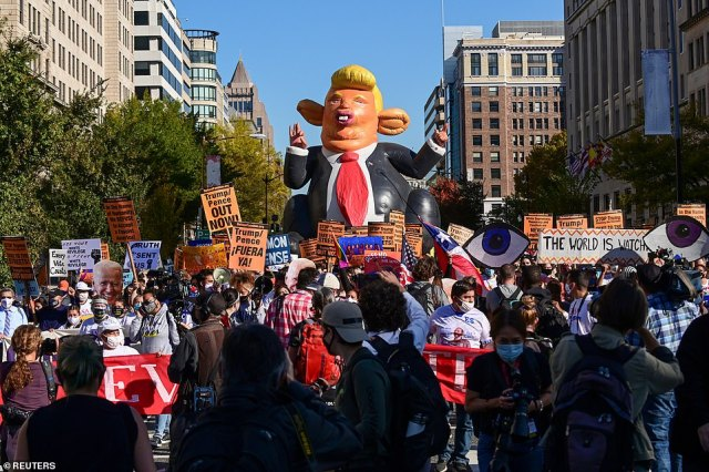 A balloon depicting US President Donald Trump is seen, as protesters march toward the White House, November 6