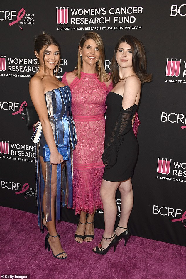 Doing time:Loughlin reported to the Federal Correctional Institution in Dublin on Friday to start her two month sentence and source told UsWeekly that she has been a 'wreck' (Pictured with daughters Oliva Jade and Isabella)