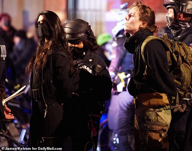 Singh, pictured left,was one of more than 50 people arrested during a night of unrest in New York