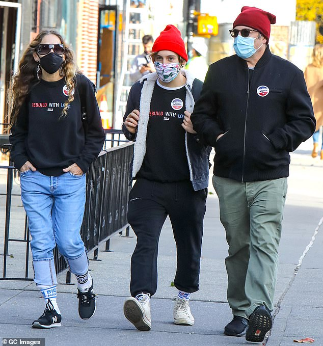 Family outing: The couple are pictured with their 18-year-old son, James, as the pair took their son to vote for the first time in NYC; pictured November 3rd