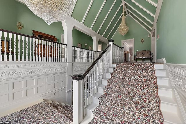 In 1999, Robert Berle, great-great grandson of William Douglas Sloane, and his wife, Sonya Berle, bought bought the property from his mother for around $1 million. Pictured: One of the home's staircases