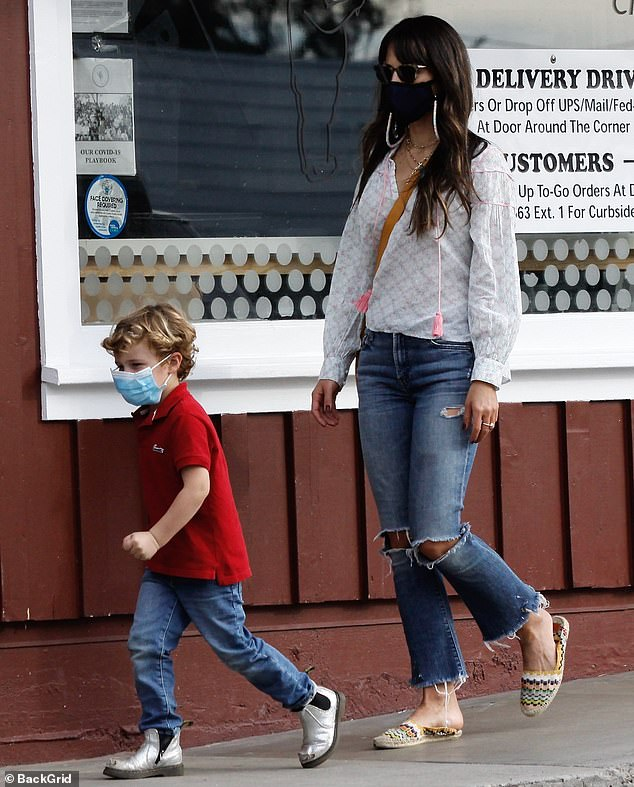 On the run: A doting mom, Jordana made sure to keep tabs on her playful tyke Rowan as she indulged him with a pastry