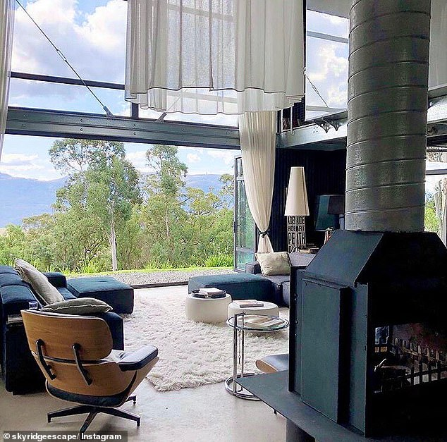 Open and bright: It also has large sliding glass windows, allowing for fresh air to breeze through and showing off views of the country side. There is also a fireplace for cosy nights in
