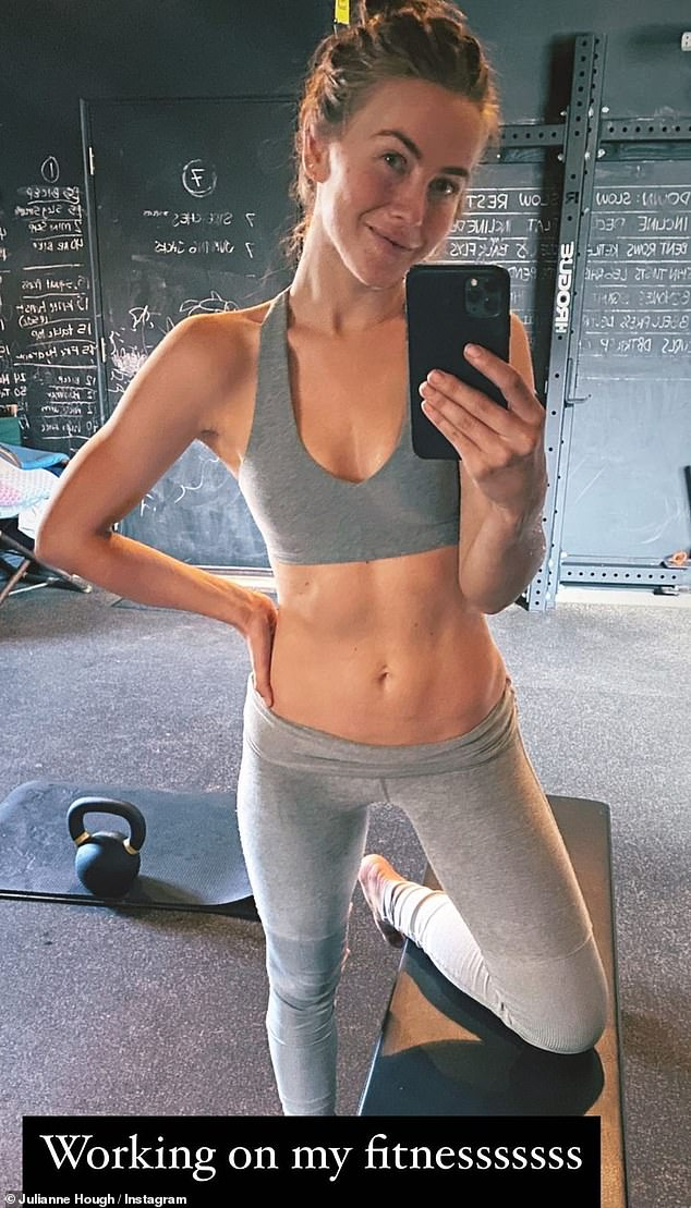 Gym bunny: The Footloose star returned to the studio Friday, sharing a mirror selfie in a grey sports bra and matching leggings