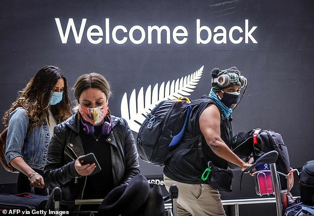 Australia has already opened its borders to allow people from New Zealand to travel here without quarantining (Pictured: passengers arrive at Sydney on October 16 after border restrictions were eased)