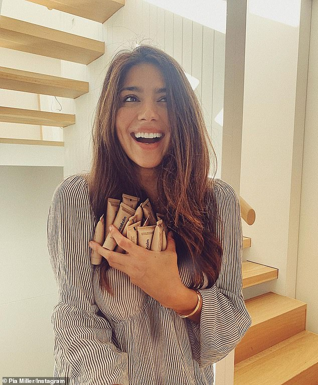 'I can barely contain my excitement!': Former Home and Away star Pia Miller has launched her clean beauty brand Macabalm. On Friday, the 37-year-old celebrated by sharing a photo of herself beaming as she cradled an armful of the organic macadamia balm tubes