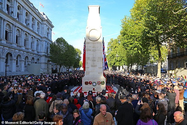 Pictured: The Cenotaph surrounded by crowds after Remembrance Sunday service in 2013. Such crowds will not be possible this year due to coronavirus lockdown measures in place