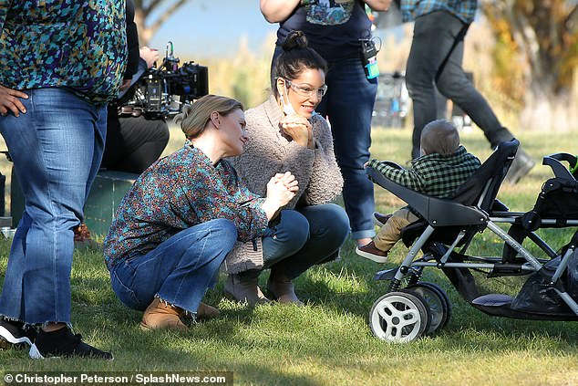 Ogling:Just like Garrett, Anna and a few other co-stars took time to marvel over their baby co-star who could not have looked more at ease on set