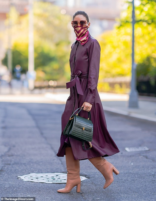 Stunning:The 34-year-old socialite concealed her enviably slender frame beneath a stunning leather mulberry toned coat