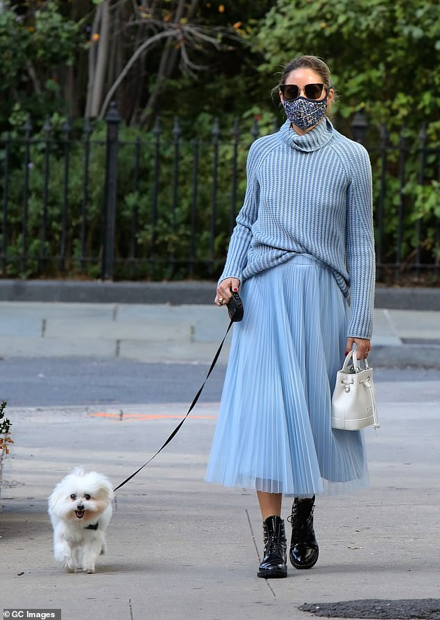 Blue is the way:'They say blue is calming,' wrote the stunner, before encouraging her followers to head to the website for more. 'Who knew we would need so much soothing energy in 2020?!'; Olivia pictured in October