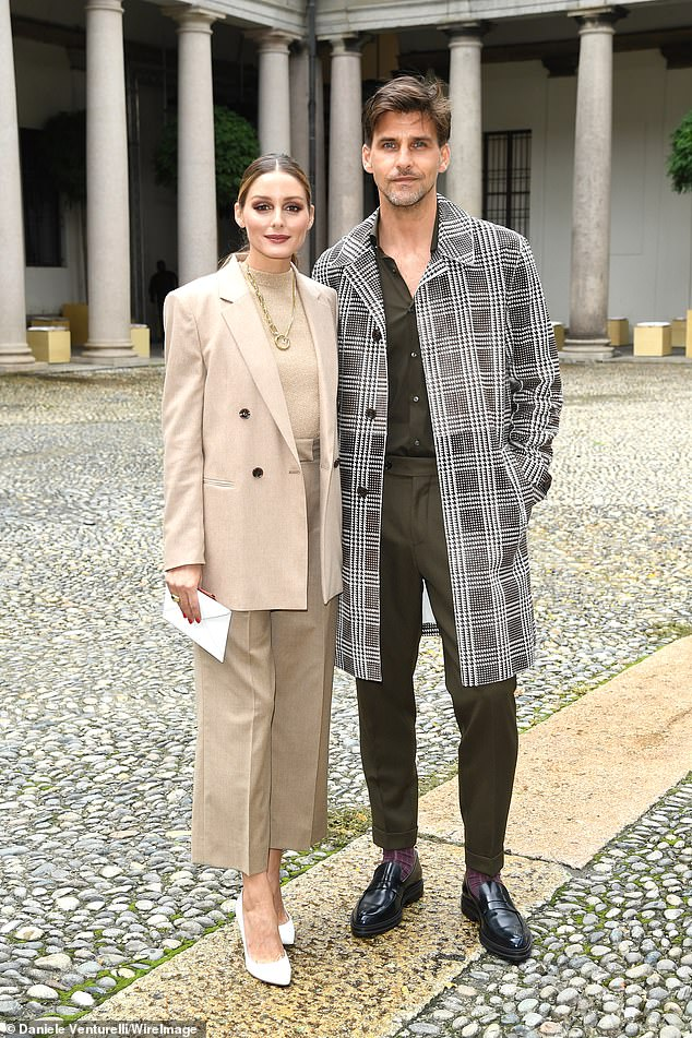 Married life:Although Olivia was eager to perform her civic duty on Tuesday, the stunner was not joined by her 42-year-old German model husband Johannes Huebl; Olivia and Johannes pictured in September