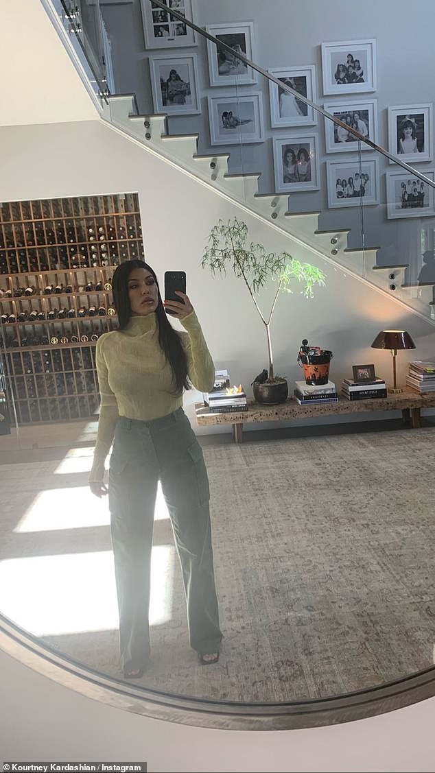 Not a care:Kourtney Kardashian embodied tranquility on Friday afternoon as she posed for selfies in her lavish Calabasas home