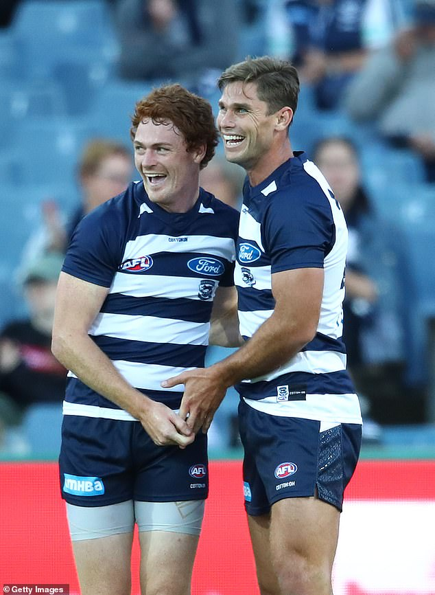 Rohan and Hawkins are pictured celebrating together after a goal during a match in 2019