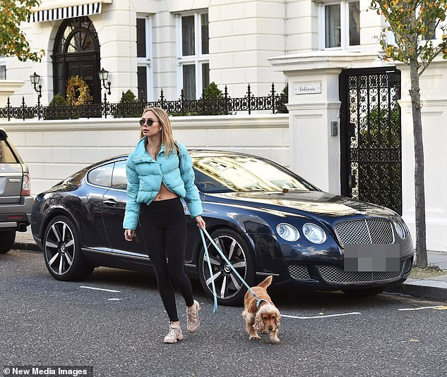 Solo outing: The star had her air pods in as she walked around London