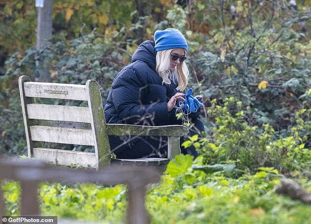 Nature: Holly sat down on a bench at one point on her walk as she waited for her friend to arrive