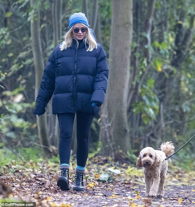Fresh air: Holly Willoughby enjoyed her day off on Friday by heading out for a socially-distanced dog walk in south London with her friend