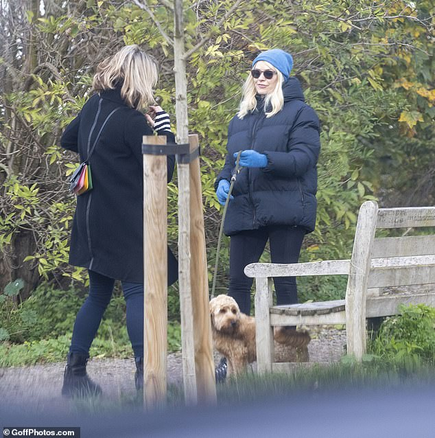 Cute: She donned a bright blue beanie hat from Scottish cashmere brand BRORA
