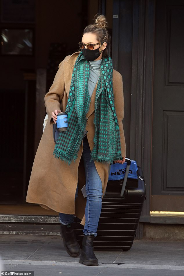 Casual chic:The former EastEnders star, 37, clearly had a busy day ahead as she lugged around a large black suitcase, before stopping for a coffee at Cafe Nero