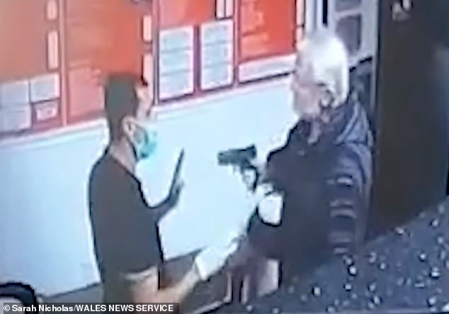 The gunman (right) pulled out a pistol after he was asked to wear a face mask by a delivery driver (left) atRhondda Takeaway in the village of Pentre, in South Wales which is in a firebreak lockdown