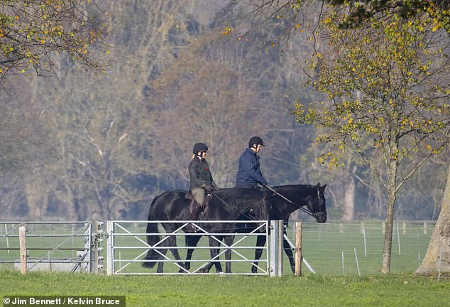 Prince Andrew is pictured horse riding to Windsor Castle today, where he was joined by a female groom