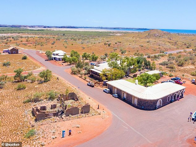 The town seen from the air. The LJ Hooker sales site says it's 50km from Karratha, and it is home to historic sites and a few crumbling ruins that will be the new owner's responsibility