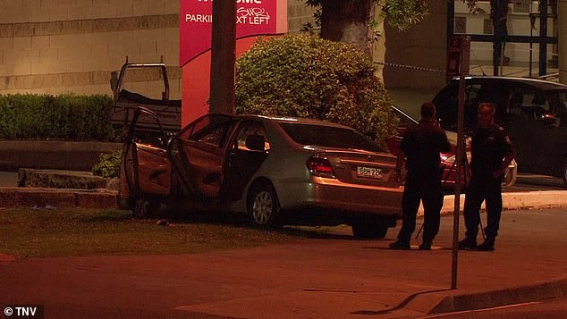 A car is seen after four pedestrians were struck in Wollongong, south of Sydney, on Saturday night