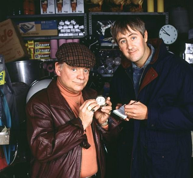 Comedy:The actor, 80, (pictured with co-star Nicholas Lyndhurst) considered using 'lovely jubbly' or 'this time next year, we'll be millionaires' as a motto on his 'rather strange' crest
