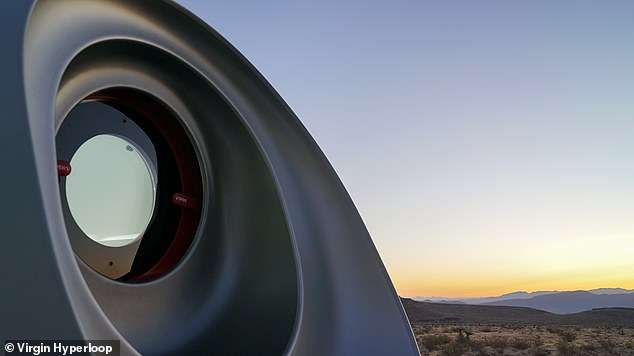 A hyperloop trip between New York and Washington would take just 30 minutes, experts have said — twice as fast as a commercial jet flight and four times faster than a high-speed train. Pictured, the front window of the hyperloop pod, seen here outside of the vacuum tube