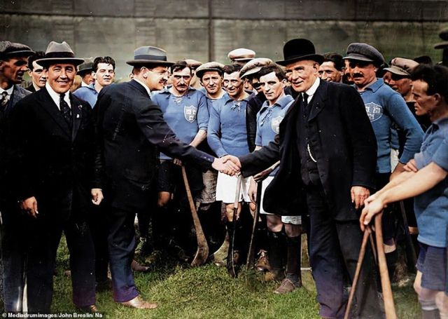 Irish revolutionary leader Michael Collins, the left of the two men shaking hands, greets a former head of the Gaelic Athletic Association at a hurling match between Dublin and Kilkenny in 1921. Collins was a veteran of the 1916 Easter Rising who later played a key role in the Anglo-Irish war of independence between 1919 and 1921 which ended in the partition of Ireland. But after agreeing to a peace treaty with the British government, he was assassinated by anti-treaty radicals in a Cork ambush