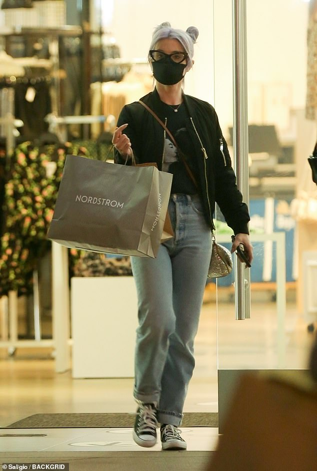 Out and about:Kelly Osbourne continued to show off her slimmed down frame as she did some early Christmas shopping at The Grove in Los Angeles
