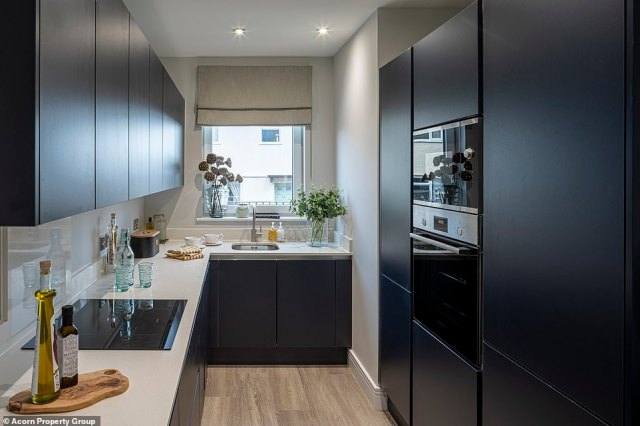 But developer Acorn Property Group has now turned the area into 157 modern abodes (pictured is the kitchen of one of the homes) - complete with a mixture of two-bedroom apartments and houses, as well as three and four-bedroom homes