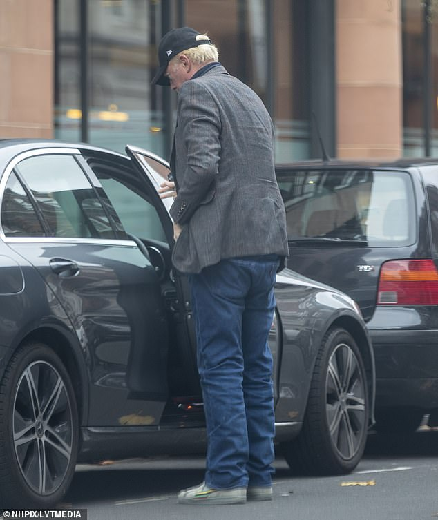 Ready to go: After spending two hours inside, Boris was seen getting into his car