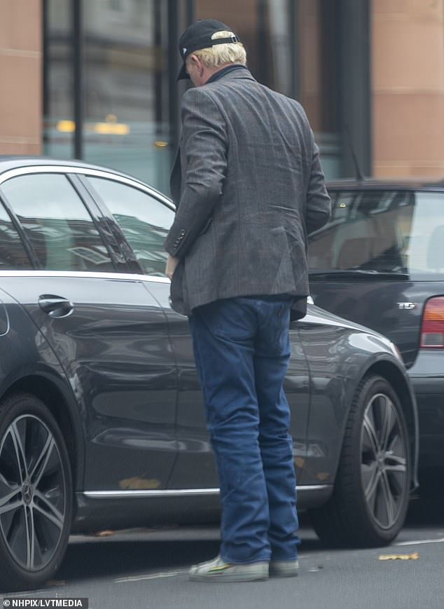 Relaxed look:Boris kept his look smart casual by wearing a pair of loose-fitting jeans that he teamed with white trainers
