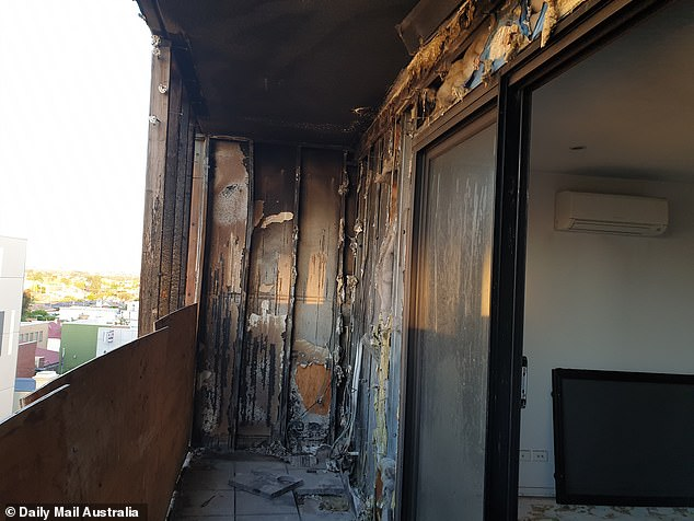 The balcony of George Ojaimi and his wife Josiane's Brunswick apartment remains wrecked three years after it went up in flames