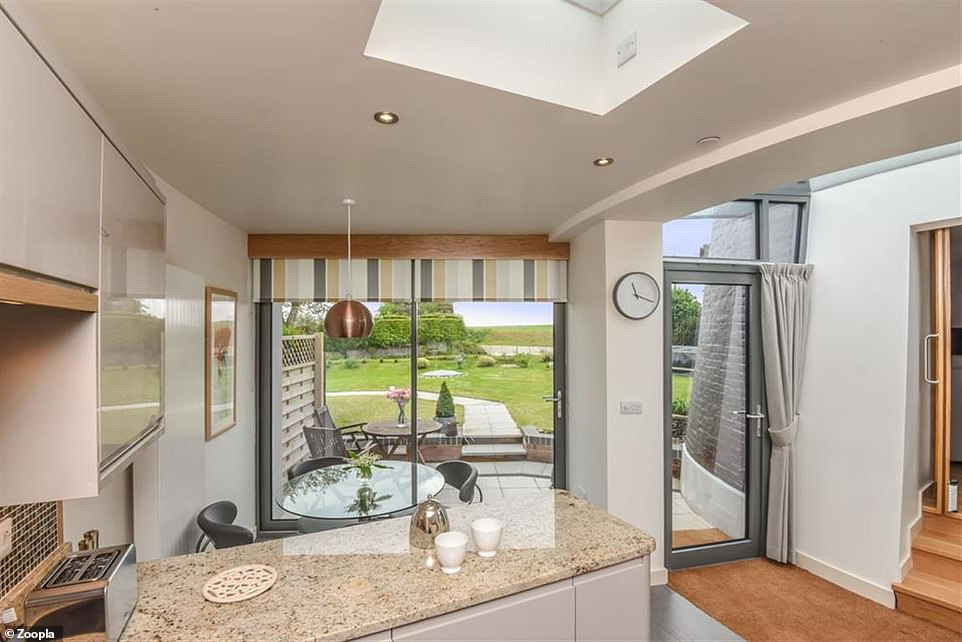 The bright and light kitchen with modern units and worktops is in the extension to the mill