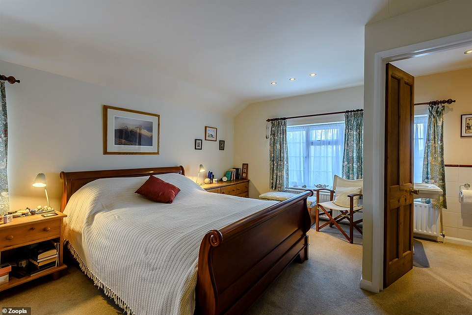 The cottage has four bedrooms including this double bedroom with an ensuite
