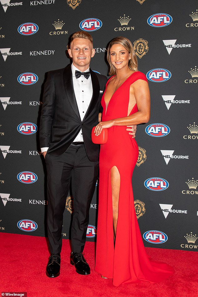 Collingwood has traded star midfielder Adam Treloar to the Western Bulldogs. He's pictured with wife Kim Ravaillion at the 2019 Brownlow Medal